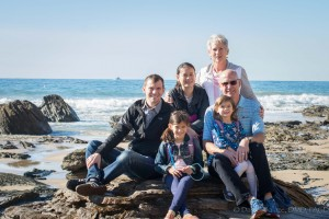 Dr. Daniel Balaze and his father Dr. Brian Balaze are both top ranked dentists. This is a photo of them with their family at Crystal Cove Beach in Orange County.